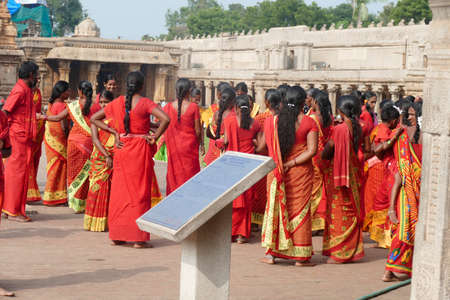 TANJORE, INDIA - DEC 29, 2019 - Women pilgrims in the   courtyard of  early 11th century Bradishwara Temple, Tanjore, Thanjavur,  Tamil Nadu , India
