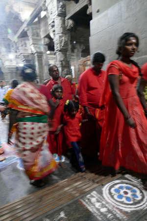 KANCHIPURAM, INDIA - DEC 26, 2019 - Women pilgrims wear red sarees in the Maha Mandapa meeting hall of the Ekambareshwara Temple, 16th - 17th century, Kanchipuram, Tamil Nadu , India Stock fotó - 140847127