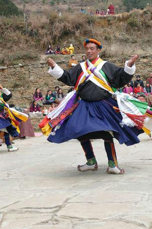 BUMTHANG, BHUTAN - DEC 13, 2019 - Nganghi Zhey (Dharma song)  dancers paying homage to their teachers, Nalakar Tsechu Dance Festival , Ngala Lhakhang Temple Bumthang,  Bhutan
