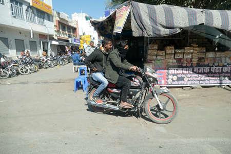 CHITTORGARH, INDIA - JAN 10, 2020 - Motorcycles in traffic on roads near Chittorgarh in Rajasthan, India