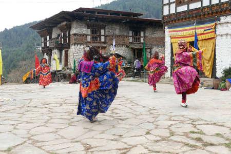 BUMTHANG, BHUTAN - DEC 13, 2019 - Blue skirt Tsholing cham wrathful deities dance to purify the ground of evil influences,  Nalakar Tsechu Dance Festival , Ngala Lhakhang Temple