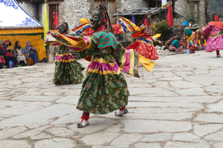 BUMTHANG, BHUTAN - DEC 13, 2019 - Green skirt Tsholing cham wrathful deities dance to purify the ground of evil influences,  Nalakar Tsechu Dance Festival , Ngala Lhakhang Temple