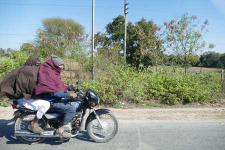 CHITTORGARH, INDIA - JAN 10, 2020 - Motorcycles in traffic on roads near  Chittorgarh in Rajasthan, India 에디토리얼