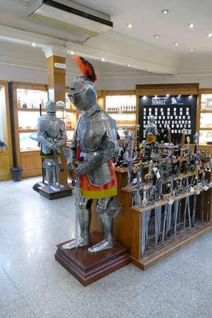TOLEDO, SPAIN - MAR 2, 2020 - Medieval knight in armor, holding a broadsword, Toledo, Spain 에디토리얼