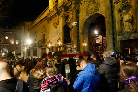 GRENADA, SPAIN - MAR 8, 2020 - Night procession enters the  church for the festival of San Juan de Dios, Granada, Andalucia, Spain