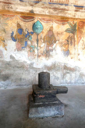 TANJORE, INDIA - DEC 29, 2019 - Shiva lingam and ancient fresco painting in the  early 11th century Bradishwara Temple, Tanjore, Thanjavur,  Tamil Nadu , India