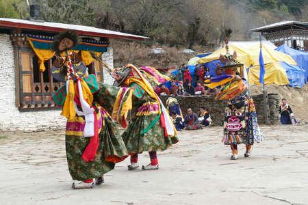 BUMTHANG, BHUTAN - DEC 13, 2019 - Green skirt Black hat dancers Zhang cham   celebrate victory of good over evil,    Nalakar Tsechu Dance Festival , Ngala Lhakhang Temple Bumthang,  Bhutan 에디토리얼