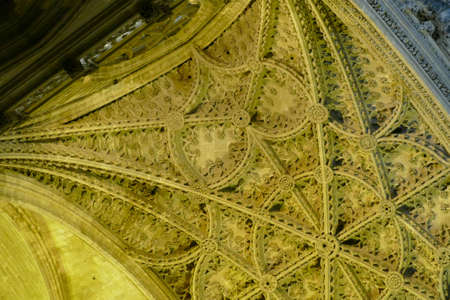 SEVILLE, SPAIN - MAR 6, 2020 - Gothic vaulted ceiling of the Mosque  Cathedral of Sevilla, Andalucia, Spain