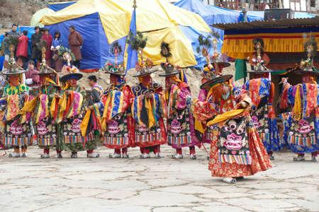BUMTHANG, BHUTAN - DEC 13, 2019 - Group of Black hat dancers Zhang cham   celebrate victory of good over evil,    Nalakar Tsechu Dance Festival , Ngala Lhakhang Temple Bumthang,  Bhutan