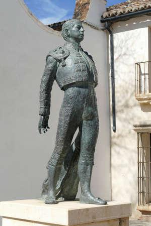 RONDA, SPAIN - MAR 2, 2020 - Matador sculpture outside the bull ring of  Ronda, Andalucia, Spain 에디토리얼