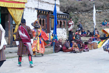 BUMTHANG, BHUTAN - DEC 13, 2019 - Local villagers attend the ritual dancing at the Nalakar Tsechu Dance Festival , Ngala Lhakhang Temple Bumthang,  Bhutan