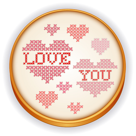 Love You Cross Stitch Embroidery design needlework sampler on retro wood sewing hoop with big red and pink hearts isolated on white