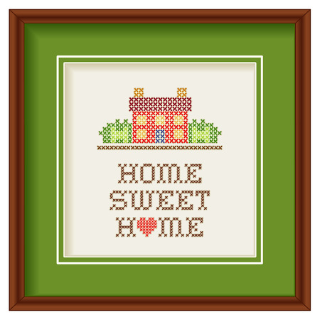 Embroidery, Home Sweet Home with a big red heart in rustic colors, needlework house in landscape graphic cross stitch sewing design isolated on white background, green mat, mahogany picture frame