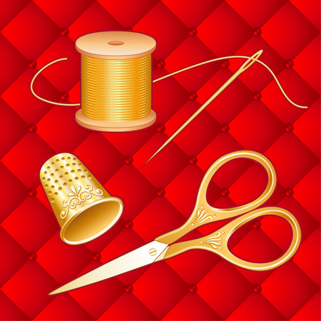 Gold Sewing Set on red quilt background with antique embroidery scissors, thimble, needle, spool of golden thread for sewing, tailoring, needlework, craft and do it yourself projects