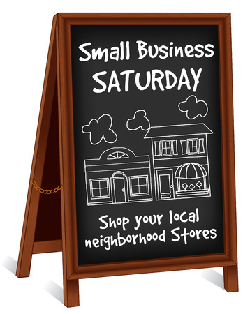 business sign: Chalk board sidewalk sign, Small Business Saturday, wood frame easel with brass chain, slate background with text to support local neighborhood stores.
