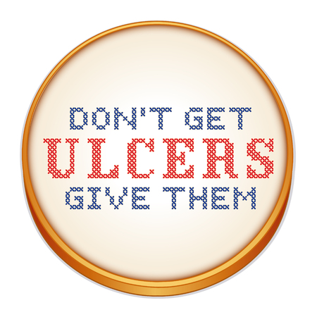 cross: Dont Get Ulcers, Give Them, fun motto, cross stitch needle craft on wood embroidery hoop isolated on white background.