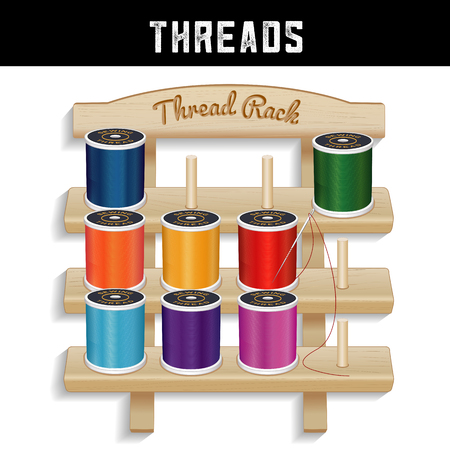 Sewing Thread Wood Rack, Needle , three shelf pine wood thread rack with engraved text, silver needle, multicolor spools of thread, isolated on white background for sewing, tailoring, quilting, crafts, embroidery, do it yourself projects.