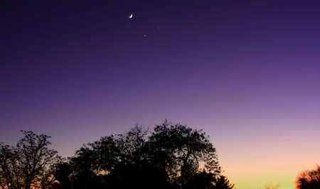 crescent: Crescent Moon Jupiter & Venus Stock Photo