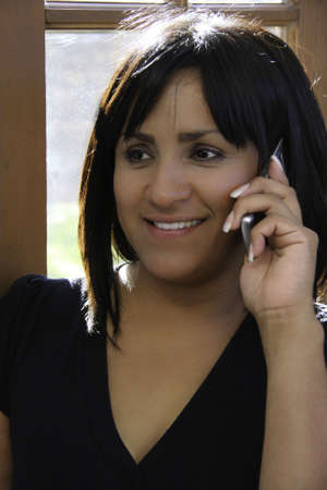 Hispanic Woman talking on a Cell Phone