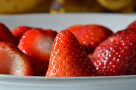 srawberries: close up of strawberries in a white bowl