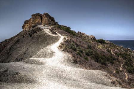 Amazing winding path on mountain ridge photo