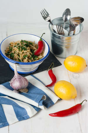 Spagettini with chilli, lemon and bread crumbs in Mediterranean style photo