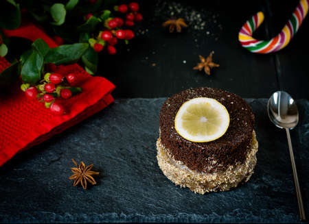 Christmas portioned chocolate cake with lemon curd in almond skirt photo