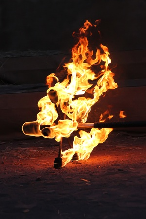 Fire staff is ablaze on the sand photo