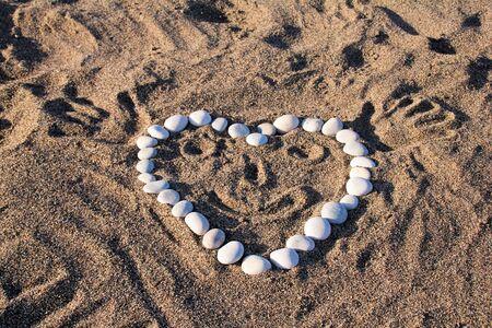 Funny heart on the beach sand Stock Photo - 12980601