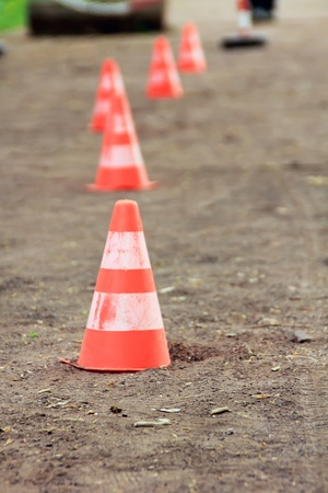 Traffic cones on the sandy road photo
