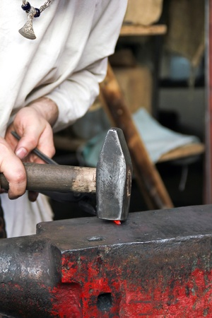 A blacksmith at the work
