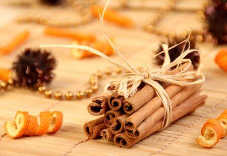 Sticks of the cinnamon with the orange peel