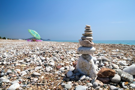 Stone pyramid on the beach photo