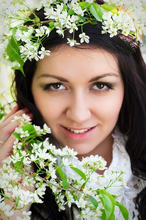 The image of a beautiful girl in the flowered garden photo