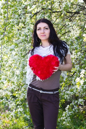 Happy young woman holding red heart Stock Photo