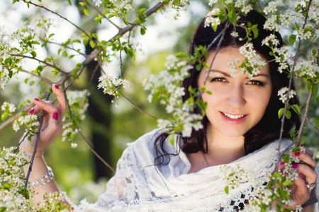 The image of a beautiful girl in the flowered garden Stock Photo - 13629101