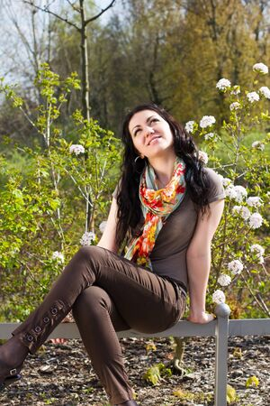 Portrait of carefree young woman in park photo
