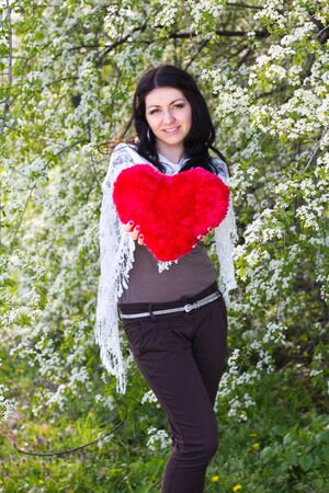 Happy young woman holding red heart Stock Photo - 14171856