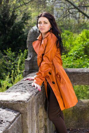 parapet: The girl leaned against a stone parapet in the park