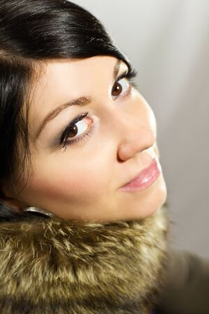 Portrait of a beautiful woman in a fur collar photo