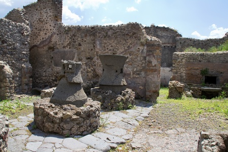 Ancient kitchen kilns used to cook food for a restaurant in Pompeii photo