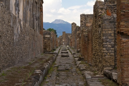 An antique roman road shot at Pompei, Italy. Stock Photo