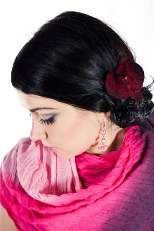 Brunette beauty portrait with orchid, studio shot Stock Photo - 14690558