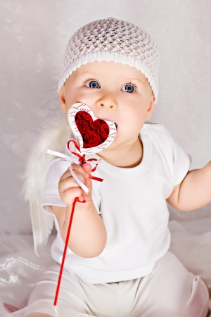 Funny girl with heart in mouth photo