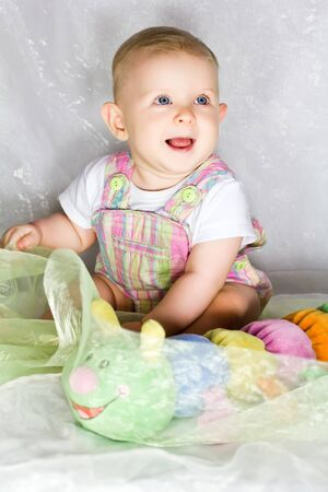 Shot of a little girl with her toy caterpillar Stock Photo - 14937414