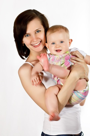 Young smiling happy mother with little baby Stock Photo
