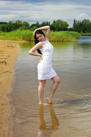 Young sexy girl at the lake shore Stock Photo - 14994996