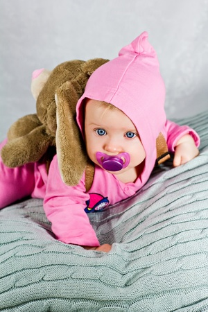 teat: Baby with rabbit rucksack and pink dummy