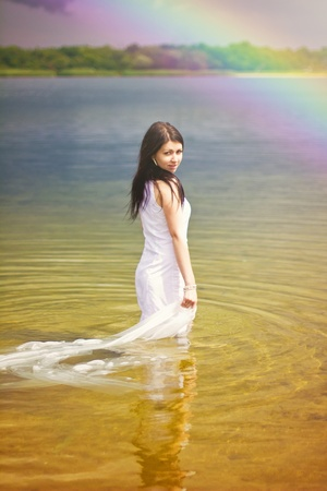 undine: Beautiful young lonely woman in lake water Stock Photo