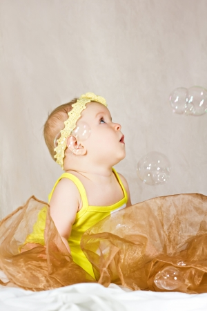 Little pretty girl with soap bubbles